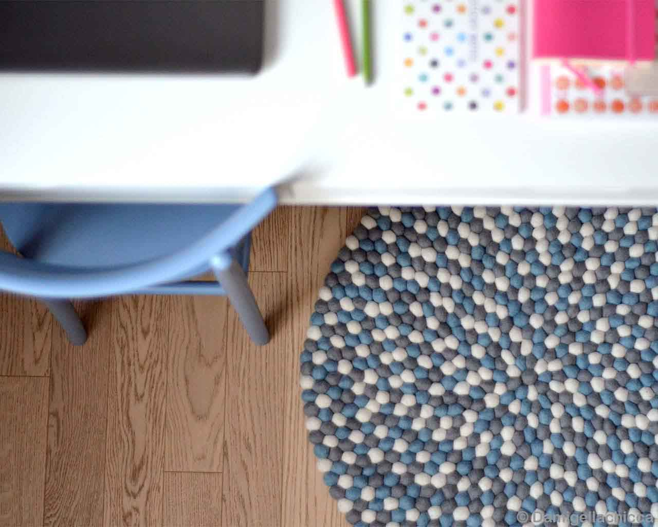 blue chair and white table nepalian made traditional vintage rugs