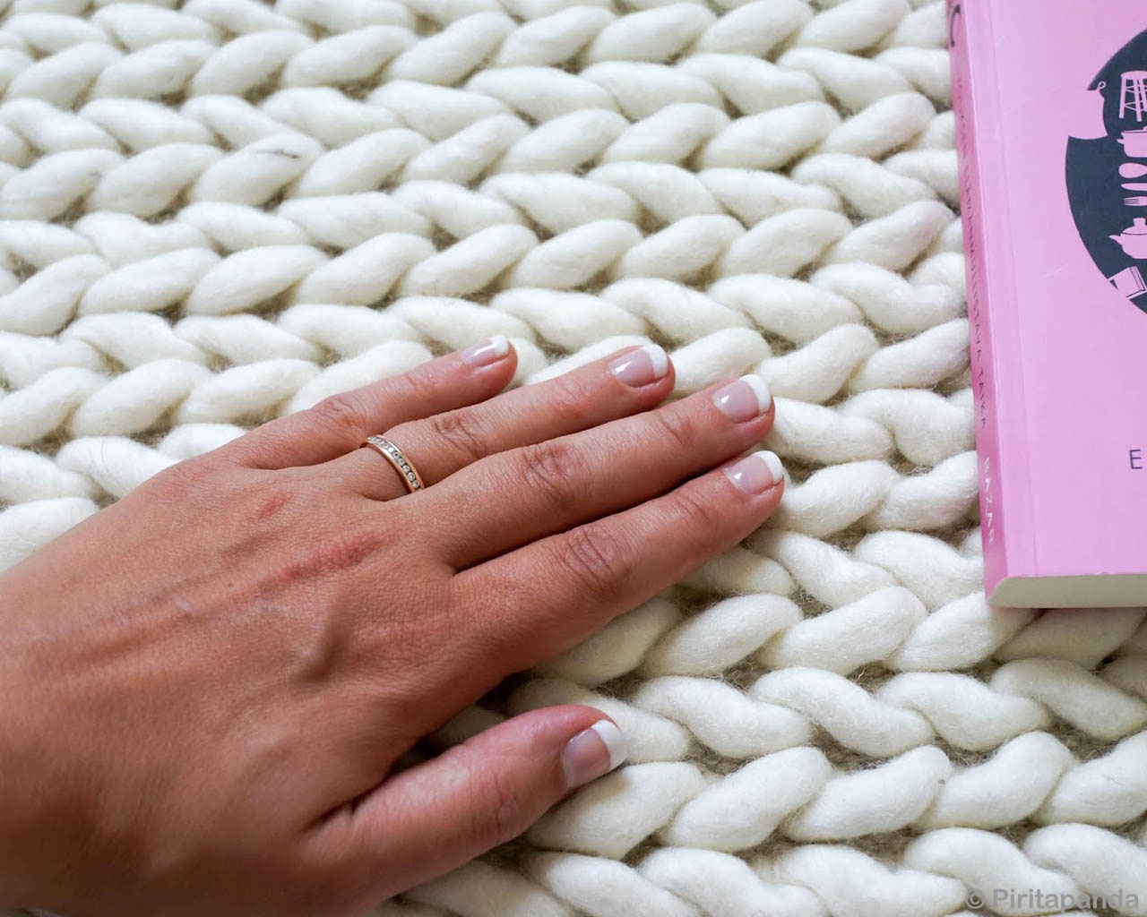 hand knotted girl hand with polished nails eastern rugs