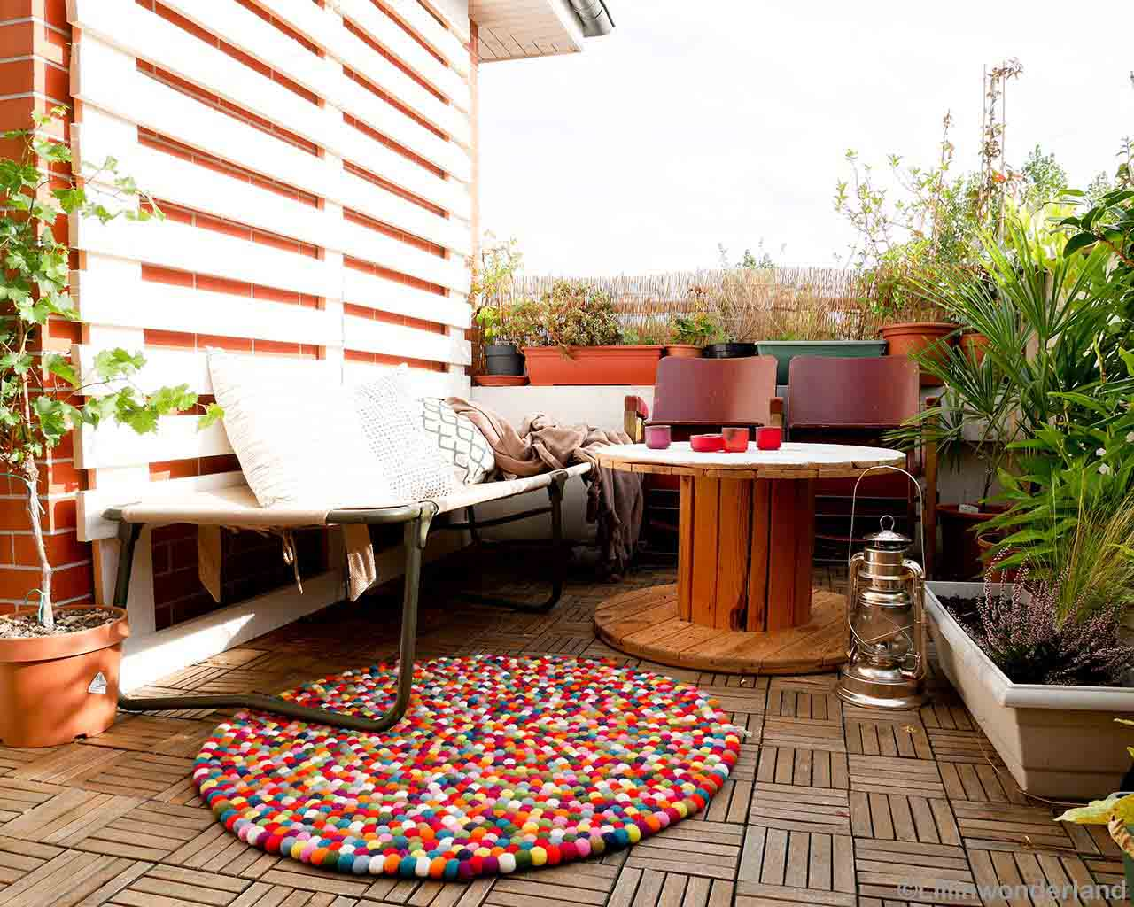 hand knotted steel outdoor bench from nepal round felt ball rugs