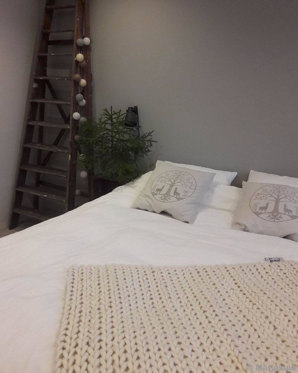 woolen white bed sheet on bed with pillows indian modern room rugs