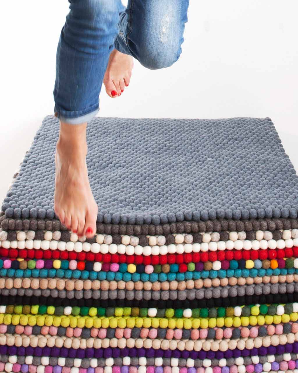 girl jumping from carpets